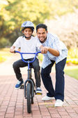 Indian boy learning ride bike — Stock Photo