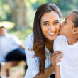 Little indian girl kissing mother — Stock Photo #49180629