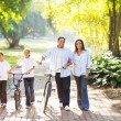 Happy indian family in park — Stock Photo #49180905