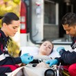 Paramedics giving first aid — Stock Photo #49182491