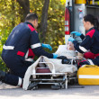 Emergency medical staff rescuing patient — Stock Photo
