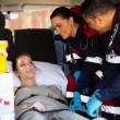 Paramedic team talking to patient — Stock Photo #49184111