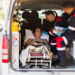 Paramedics talking to patient — Stockfoto