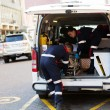 Paramedics offloading patient — Stock Photo #49184191