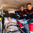 Paramedic team and patient — Stockfoto