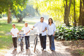Happy indian family in park — Stock Photo