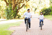 Father and daughter riding bikes — Stock Photo