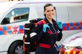 Female paramedic carrying lifepack — Stock Photo