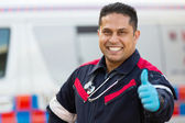 Medical technician giving thumb up — Stock fotografie
