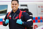 Paramedic carrying portable equipment — 图库照片