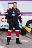 Paramedic carrying portable medical equipments — Stock Photo