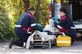 Emergency medical staff rescuing patient — Foto Stock