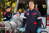 Paramedic with colleague and patient — Stock Photo