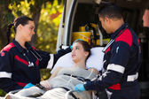 Paramedic team talking to patient — Stock Photo