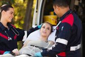 Paramedics talking to patient — Stock Photo