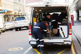 Paramedics offloading patient — Stock Photo