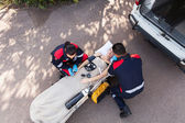 Paramedic team providing first aid — Stockfoto
