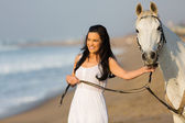 Woman walking with horse — Stock Photo