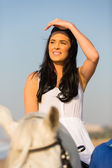 Pretty woman riding horse — Stock Photo