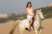 Woman enjoying riding on horse — Stock Photo