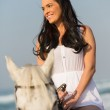 Smiling young woman riding horse — Stock Photo #49236303
