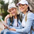 Tourists holding map — Stock Photo #49239115