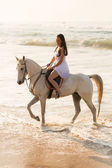 Lady horse rider on beach — Stock Photo