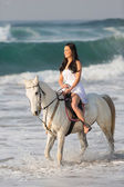 Woman horse rider in water — Stock Photo