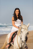 Beautiful woman on horse — Stock Photo