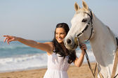 Happy woman with her horse — Stock Photo