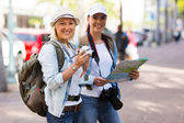 Tourists in town — Stock Photo