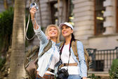 Tourists taking self portrait — Stock Photo