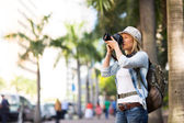 Tourist taking photos in city — Stock Photo