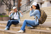 Tourist photographing her friend — Stok fotoğraf