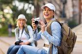 Cheerful tourist holding camera — Stock Photo