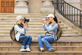 Tourists photographing each other — Stock Photo