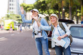 Tourists calling for taxi — Stock Photo