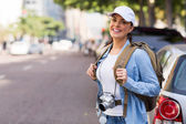 Tourist standing on sidewalk — Stock Photo