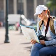 Tourist checking directions on map — Stock Photo #49241581