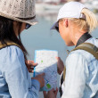 Female tourists looking at map — Stock Photo #49243313