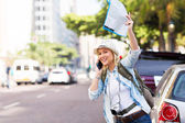 Tourist hailing taxi — Stock Photo