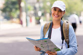 Young tourist holding map — Stock Photo
