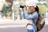 Young female tourist taking pictures — Stock Photo