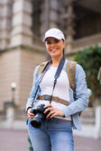 Female tourist with digital camera — Stock Photo