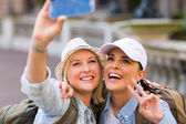 Tourists taking selfie with phone — Stock Photo