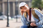 Tourist with backpack relaxing — Stock Photo