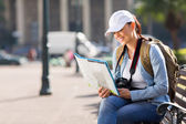 Tourist checking directions on map — Stock Photo