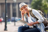 Female traveller holding map — Stock Photo