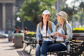 Female tourists relaxing during tour — Stock Photo