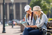 Tourists looking at map — Stock Photo